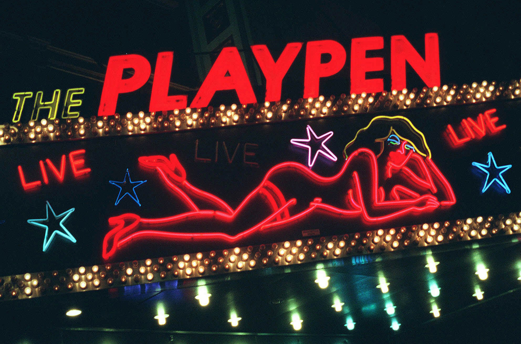 FILE - This March 6, 1998, file photo shows a detail from a neon sign above a strip club in New York's Times Square photographed after a judge conclud...