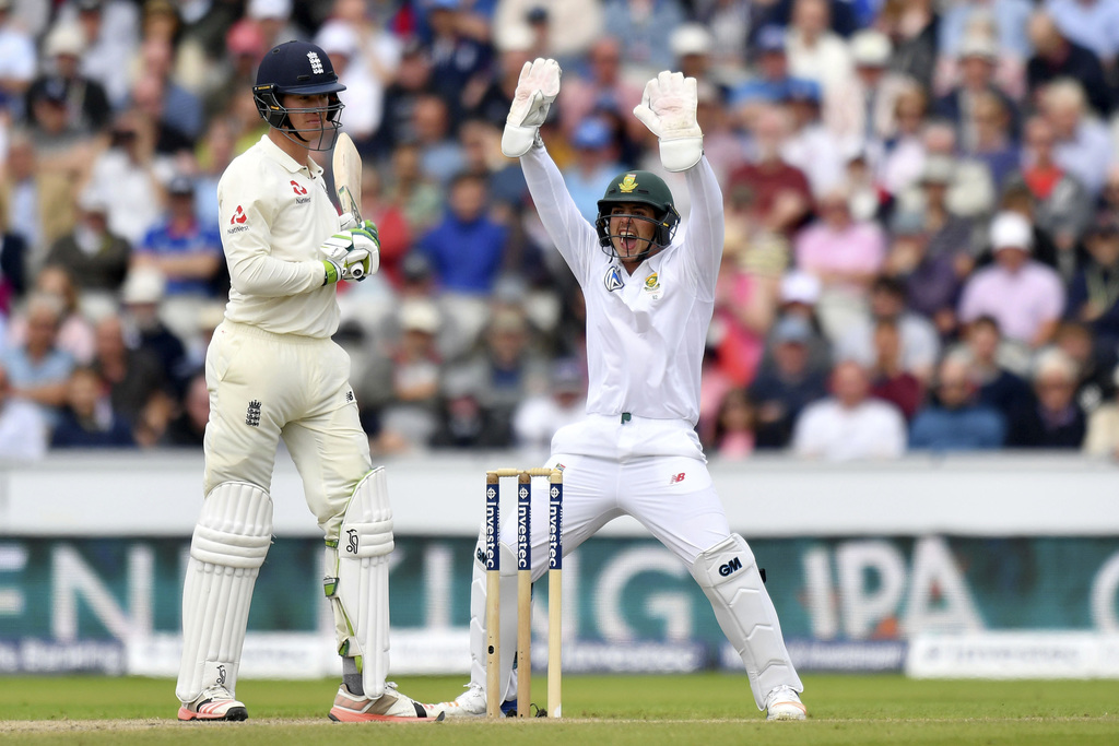 England's Keaton Jennings, left, survives an lbw appeal from South Africa's Quinton de Kock, during day three of the Fourth Test match at Emirates Old...