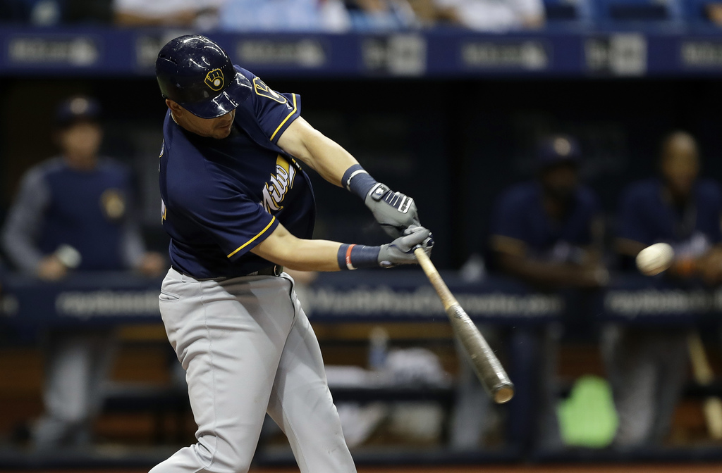 Milwaukee Brewers' Hernan Perez connects for a home run off Tampa Bay Rays pitcher Ryne Stanek during the eighth inning of a baseball game Saturday, A...