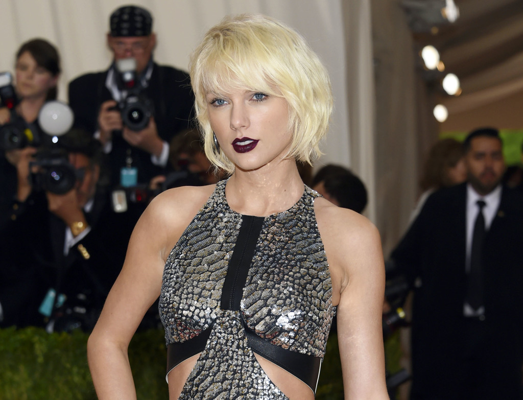 FILE - In this May 2, 2016 file photo, Taylor Swift arrives at The Metropolitan Museum of Art Costume Institute Benefit Gala in New York. The trial of...