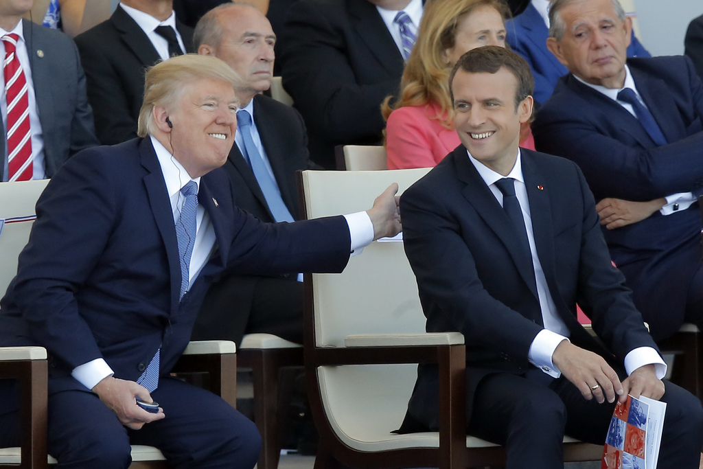 FILE - A Friday, July 14, 2017 file photo of French President Emmanuel Macron, right, and U.S. President Donald Trump attending the traditional Bastil...