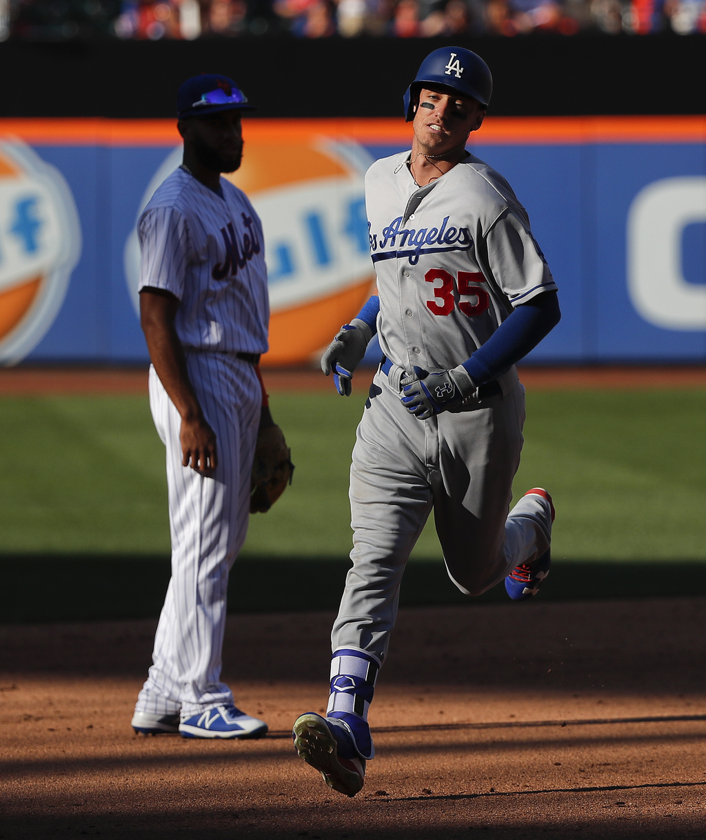 Los Angeles Dodgers' Cody Bellinger (35) rounds the bases after hitting a two-run home run against the New York Mets during the sixth inning of a base...