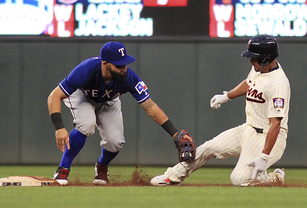 Minnesota Twins' Eduardo Escobar (5) is tagged out at second by Texas Rangers second baseman Rougned Odor (12) while trying to stretch a hit out in th...