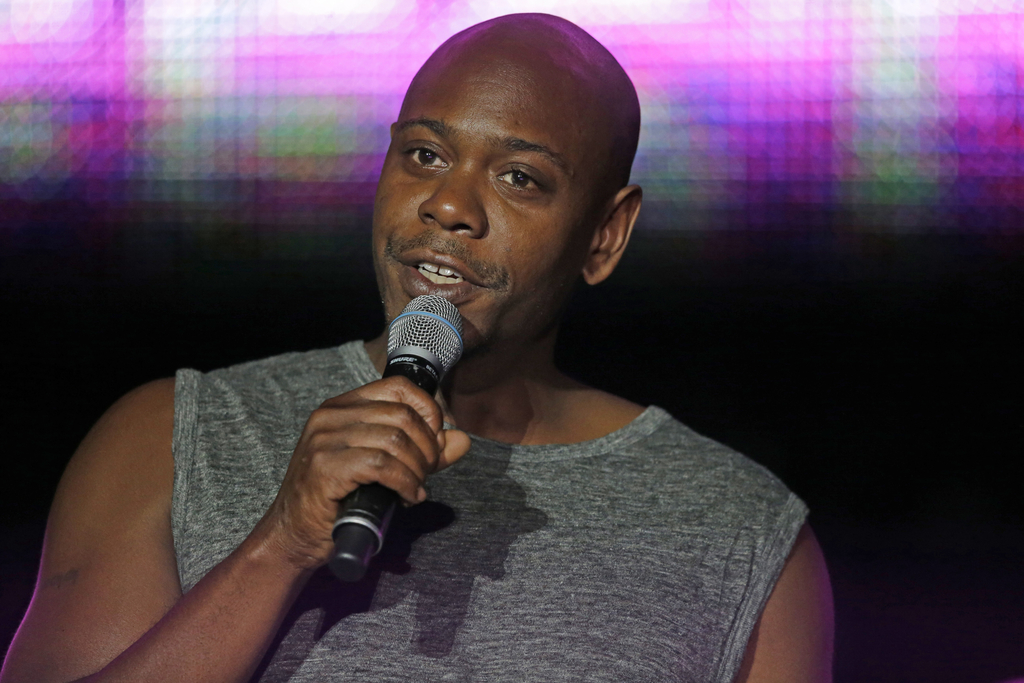FILE - This Sunday, July 6, 2014 file photo, Dave Chappelle performs at the Essence Festival in New Orleans.  As Dave Chappelle reflects on spending 3...