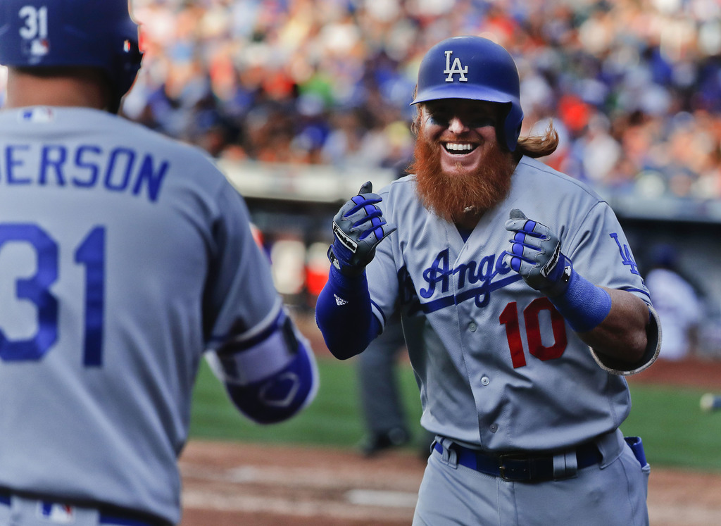 Los Angeles Dodgers' Justin Turner (10) celebrates after hitting a solo home run against the New York Mets during the eighth inning of a baseball game...