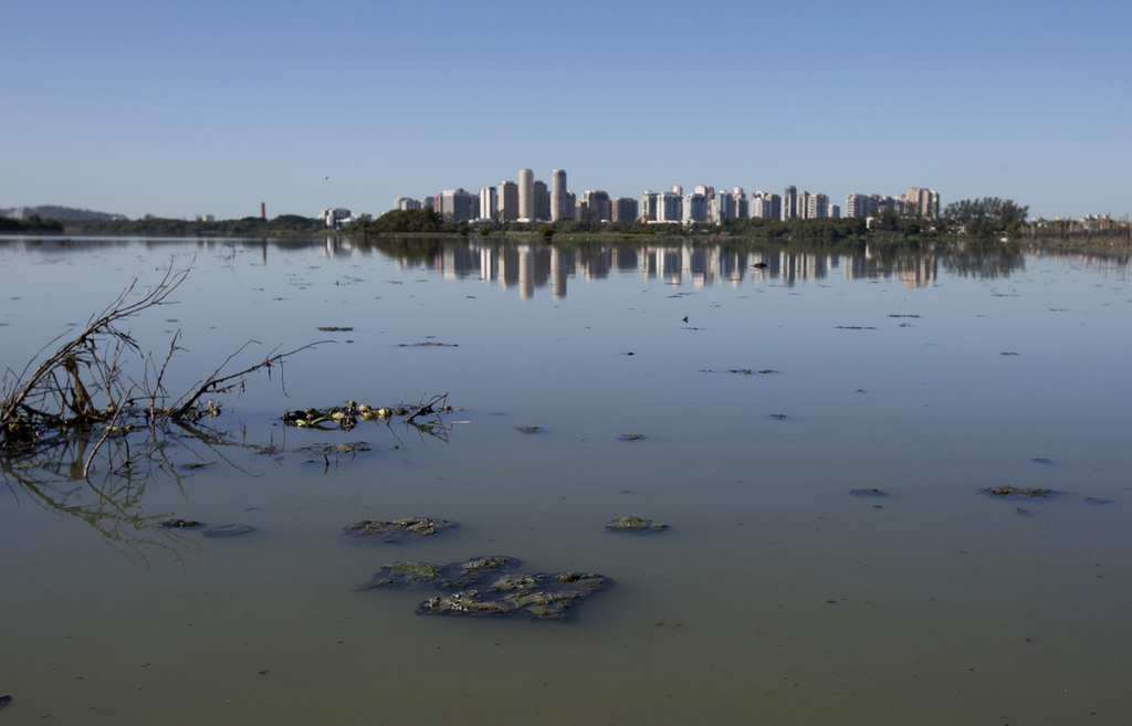 This July 31, 2017 photo, shows the heavily polluted Jacarepagua lagoon, in Rio de Janeiro, Brazil. In it's Olympic bid, Rio promised to clean up the ...