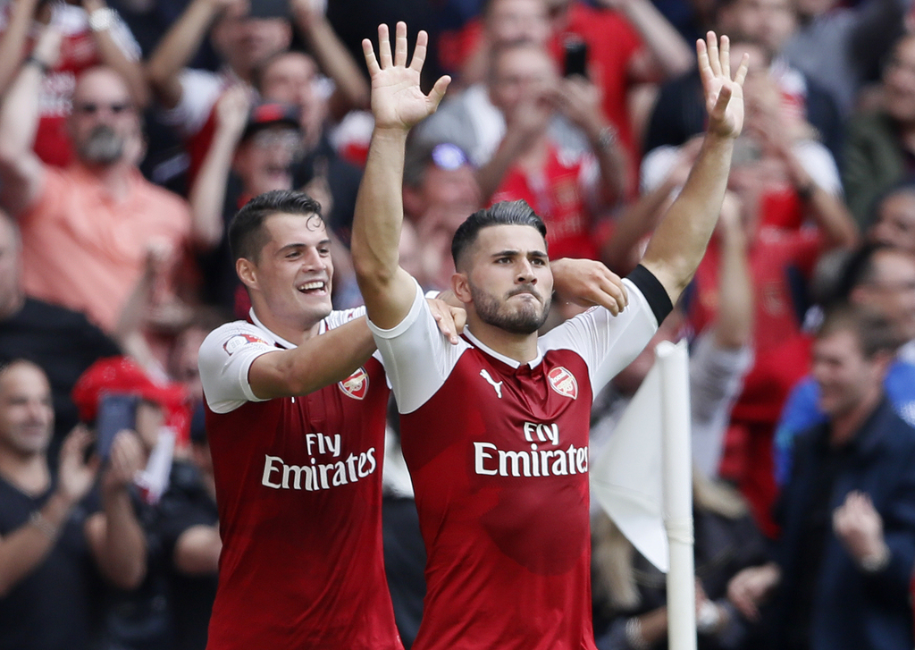 Arsenal's Sead Kolasinac, right, celebrates scoring his sides first goal during the English Community Shield soccer match between Arsenal and Chelsea ...