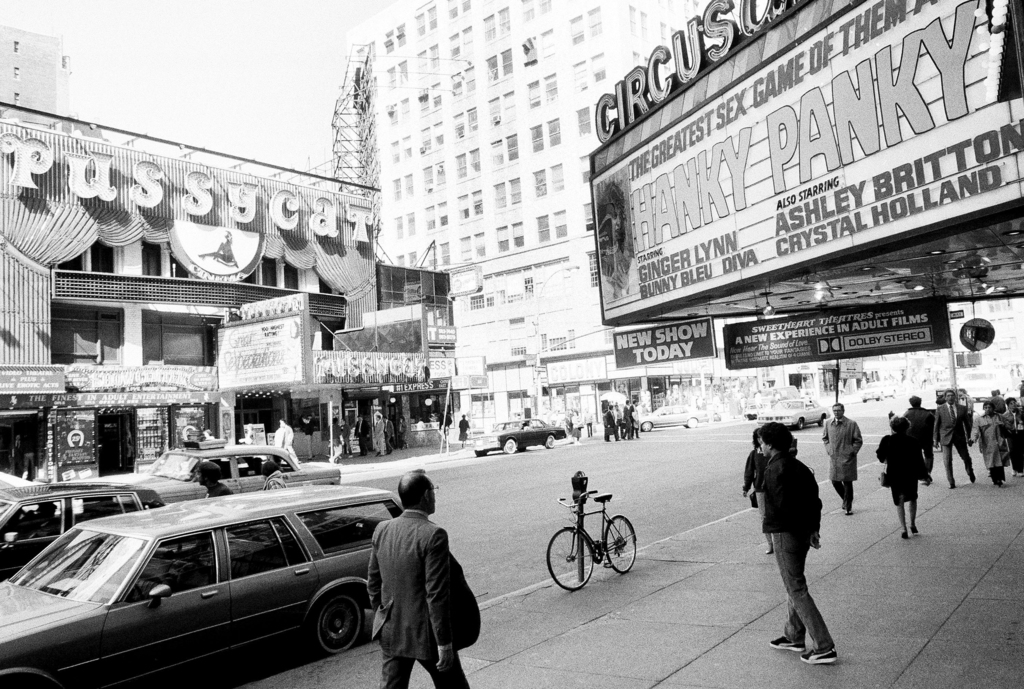 FILE - This Oct. 4, 1984 file photo shows porn shops and peep shows in New York's Times Square. New York City's two-decade legal war on storefront por...