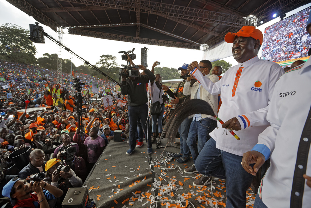 Main opposition leader Raila Odinga, right, dances in front of his supporters at his final electoral campaign rally at Uhuru Park in Nairobi, Kenya Sa...