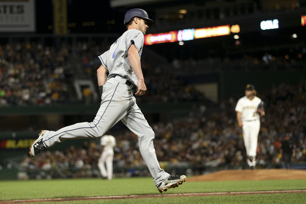 San Diego Padres' Wil Myers, left, rounds third base after hitting a two-run home run off Pittsburgh Pirates starting pitcher Gerrit Cole, right, duri...