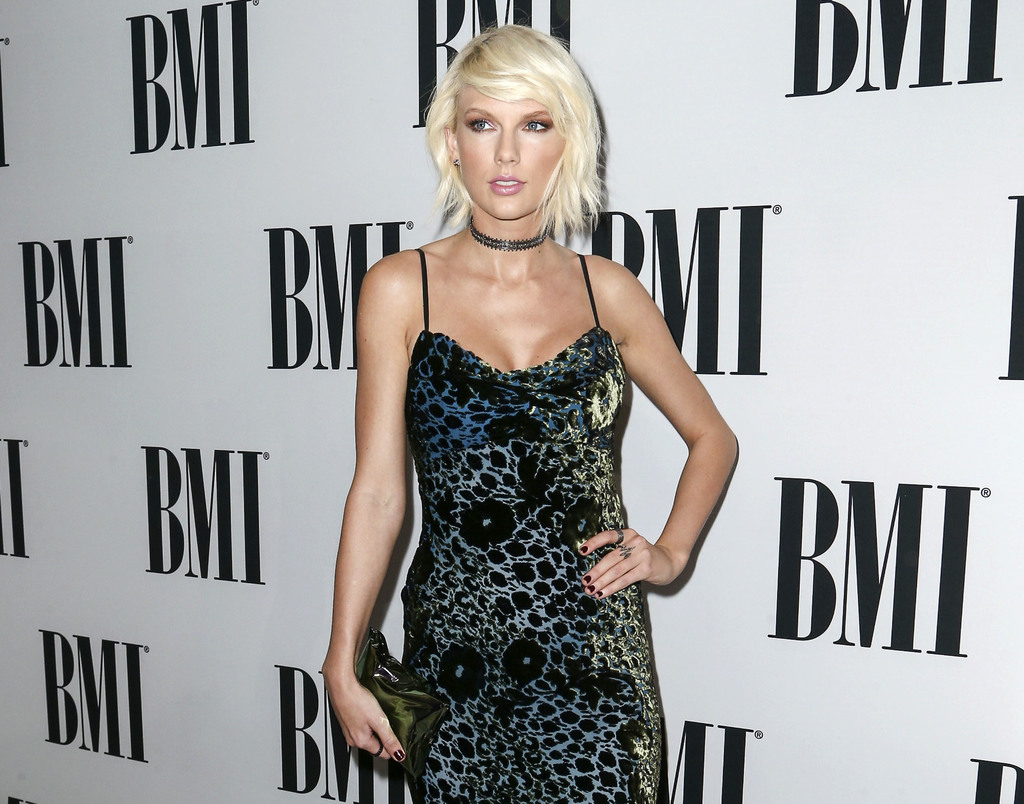FILE - In this May 10, 2016 file photo, Taylor Swift arrives at the 64th annual BMI Pop Awards in Beverly Hills, Calif. The trial of a lawsuit between...