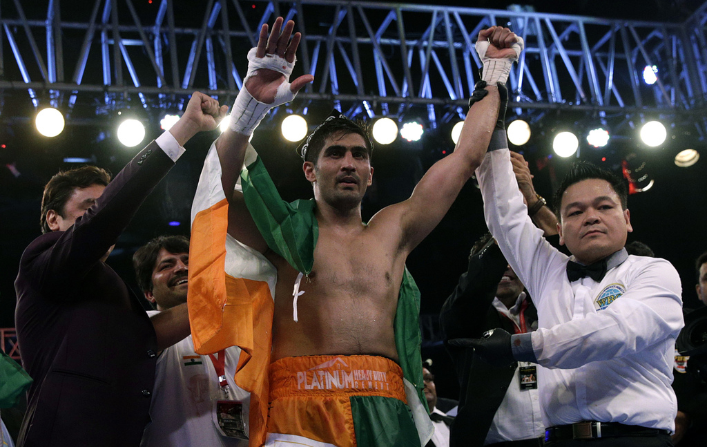 Indian boxing and WBO Asia-Pacific Super Middleweight champion Vijender Singh celebrates after winning the double title against WBO Oriental Super Mid...