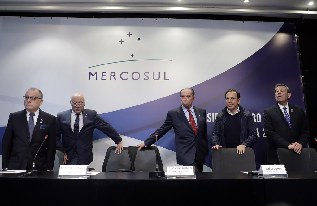 In this Saturday, Aug. 5, 2017 photo, Foreign Ministers from countries that belong to the Mercosur trade block gather to give a statement to the media...