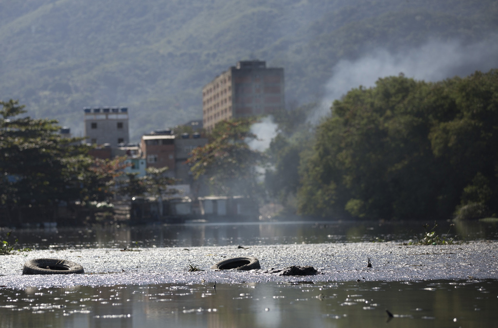 In this July 31, 2017 photo, shows Rio das Pedras neighborhood on the shores of the heavily  polluted Jacarepagua lagoog, in Rio de Janeiro, Brazil. I...