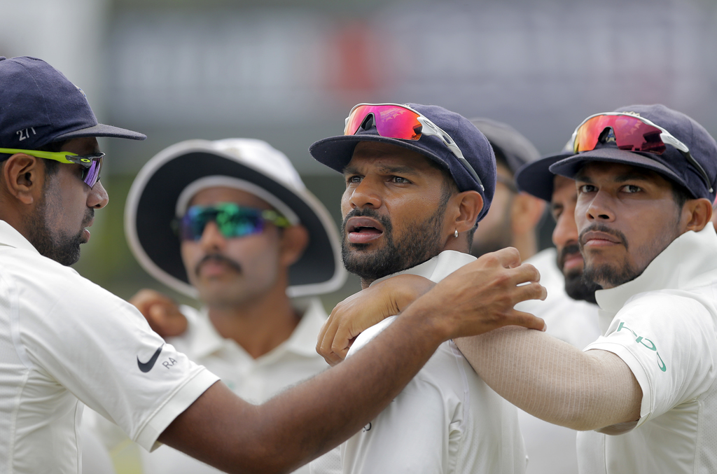 Indian players stand in a huddle before the start of fourth day's play of their second cricket test match against Sri Lanka in Colombo, Sri Lanka, Sun...