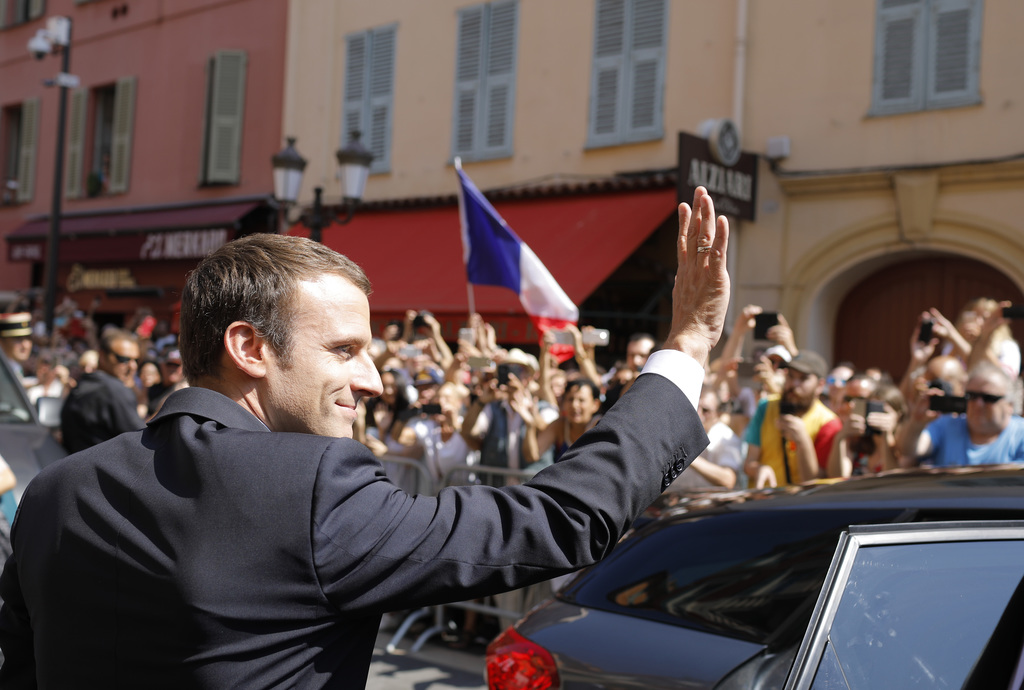 FILE - In this Friday, July 14, 2017 file photo, French President Emmanuel Macron waves as he arrives in Nice, southern France. Less than three months...