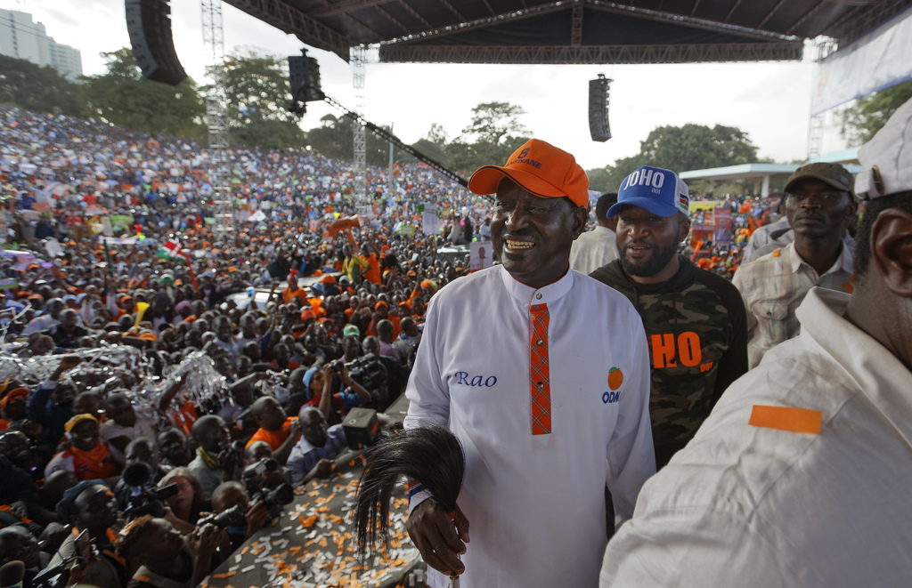 Main opposition leader Raila Odinga, center, smiles after greeting his supporters at his final electoral campaign rally at Uhuru Park in Nairobi, Keny...
