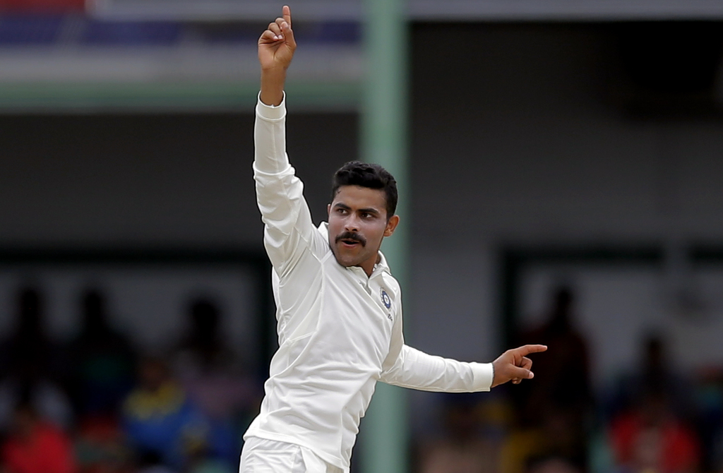 India's Ravindra Jadeja celebrates the dismissal of Sri Lanka's Dimuth Karunaratne during the fourth day's play of their second cricket test match in ...