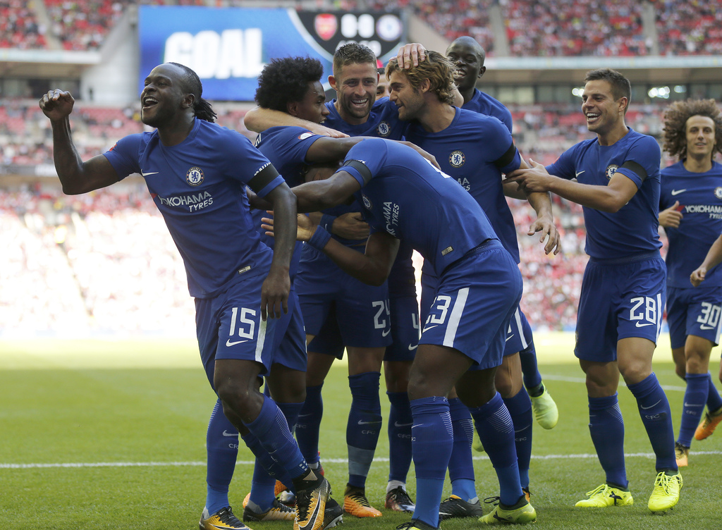 Chelsea's Victor Moses, left, celebrates with teammates after scoring his side's first goal during the English Community Shield soccer match between A...