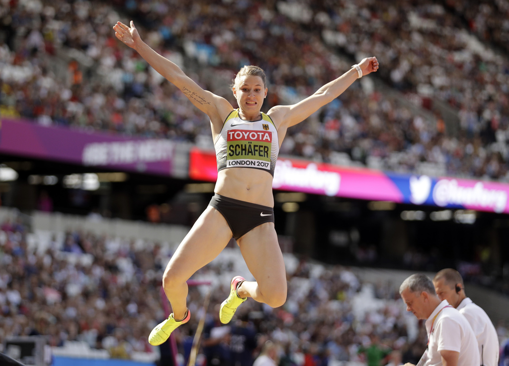 Germany's Carolin Schaefer makes an attempt in the long jump of the heptathlon during the World Athletics Championships in London Sunday, Aug. 6, 2017...