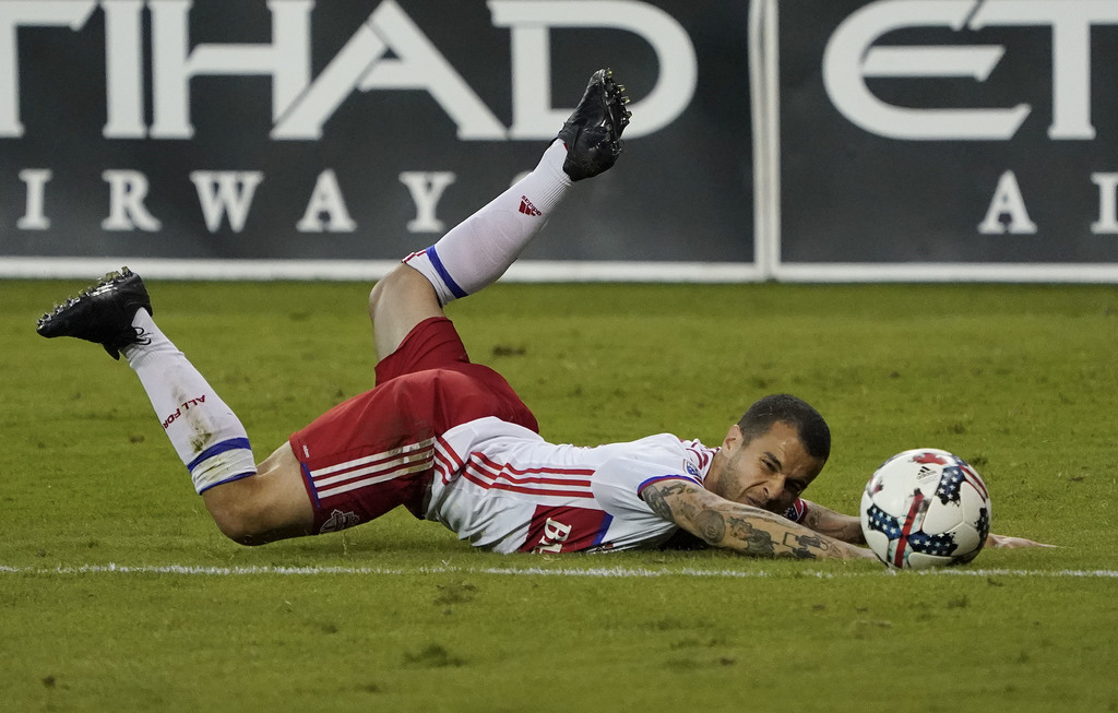Toronto FC forward Sebastian Giovinco falls to the ground after losing control of the ball during the second half against D.C. United in an MLS soccer...
