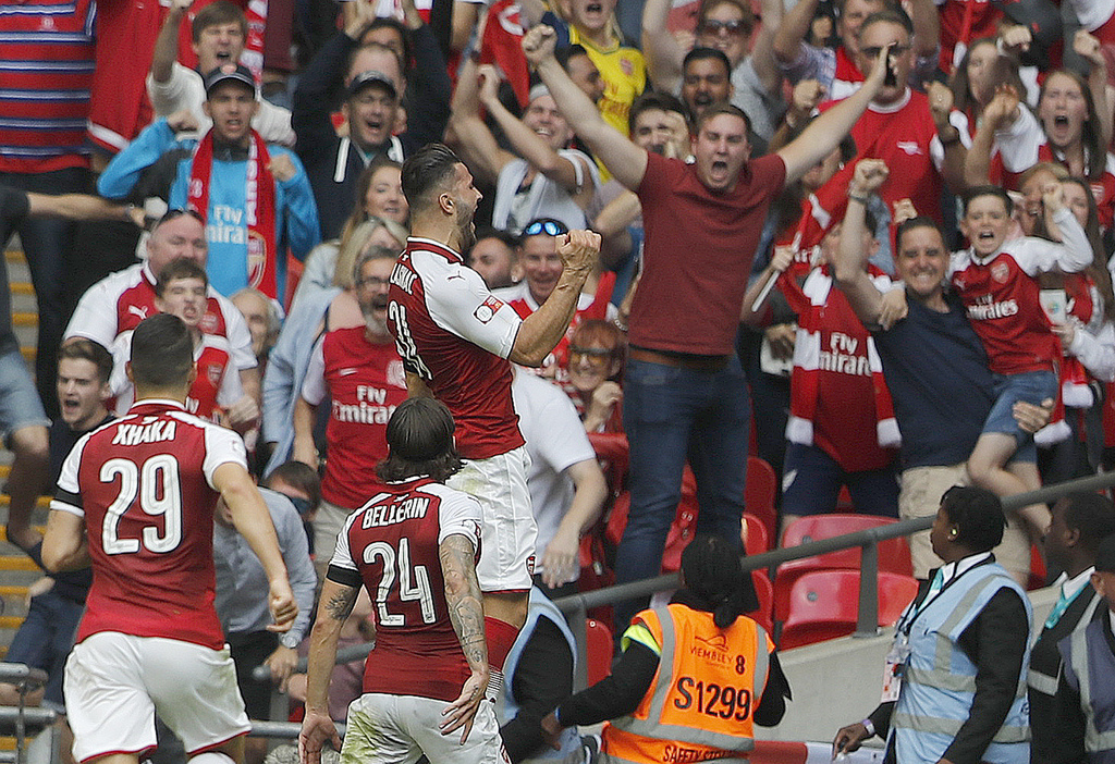 Arsenal players celebrate after scoring during the English Community Shield soccer match between Arsenal and Chelsea at Wembley Stadium in London, Sun...