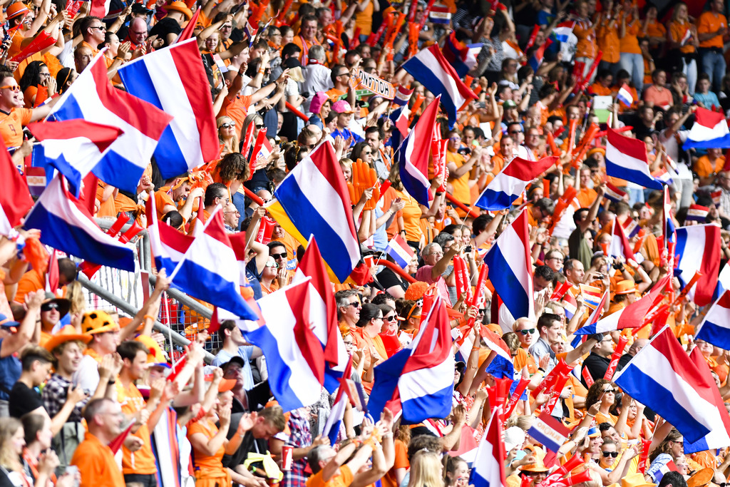 Dutch soccer fans wave a flags during the Women's Euro 2017 final soccer match between Netherlands and Denmark in Enschede, the Netherlands, Sunday, A...