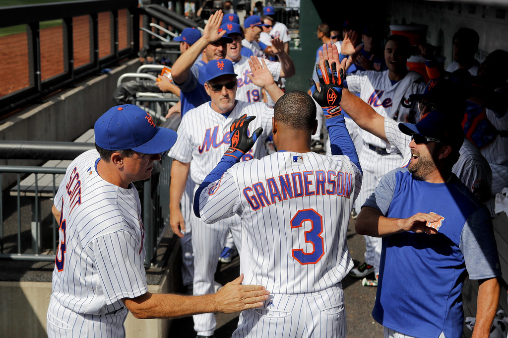 New York Mets' Curtis Granderson (3) is congratulated by teammates after hitting a solo home run against the Los Angeles Dodgers during the first inni...