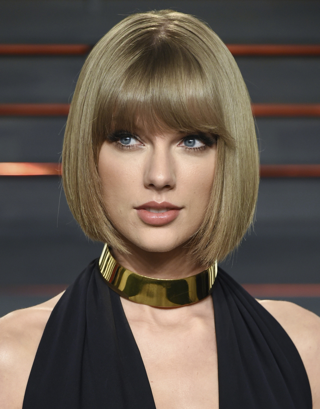FILE - In this Feb. 28, 2016 file photo, singer Taylor Swift attends the Vanity Fair Fair Oscar Party in Beverly Hills, Calif. The trial of a lawsuit ...
