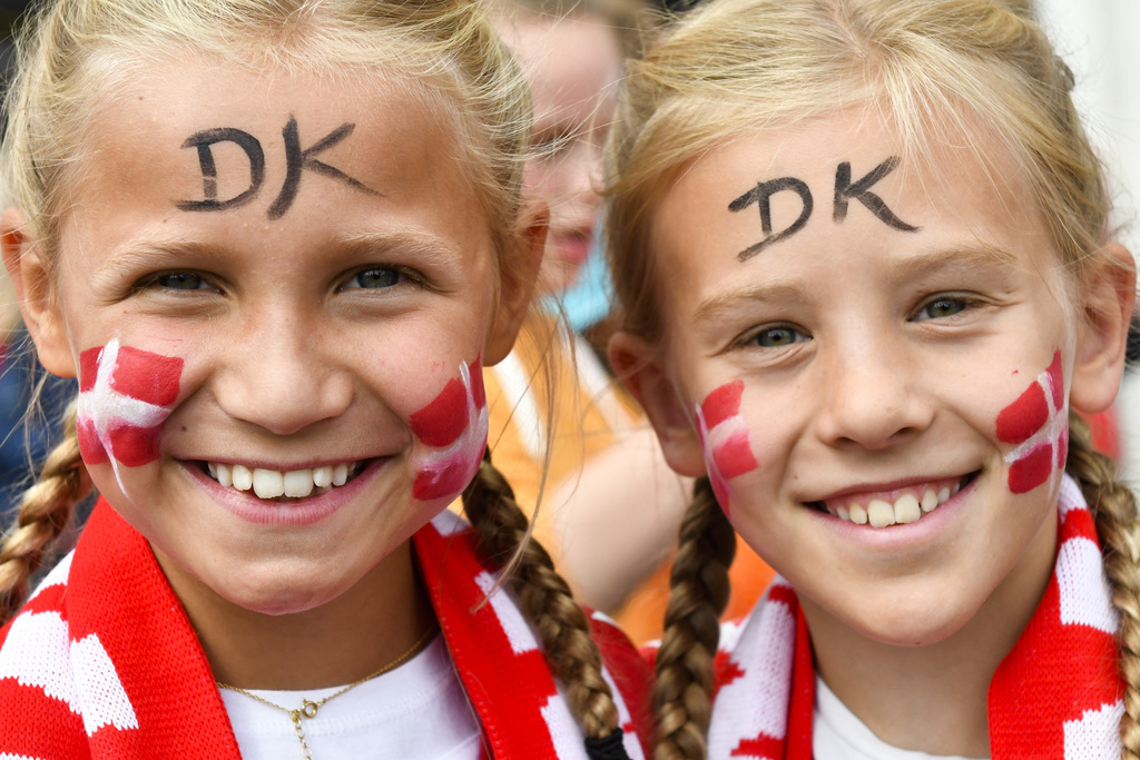 Two girls, supporter of Denmark's women national soccer team, smiles as they arrive in front of the stadium prior to the Women's Euro 2017 final socce...