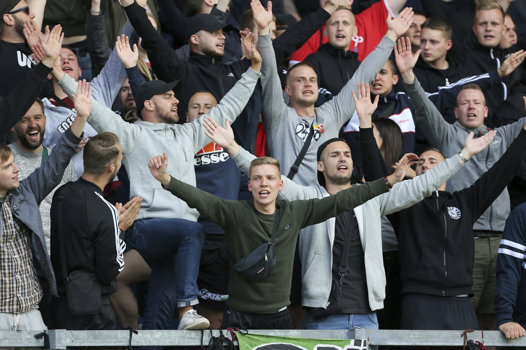 Hannover soccer club fans react in the stands after the game against Burnley is abandoned during the pre-season friendly match at Turf Moor, Burnley, ...