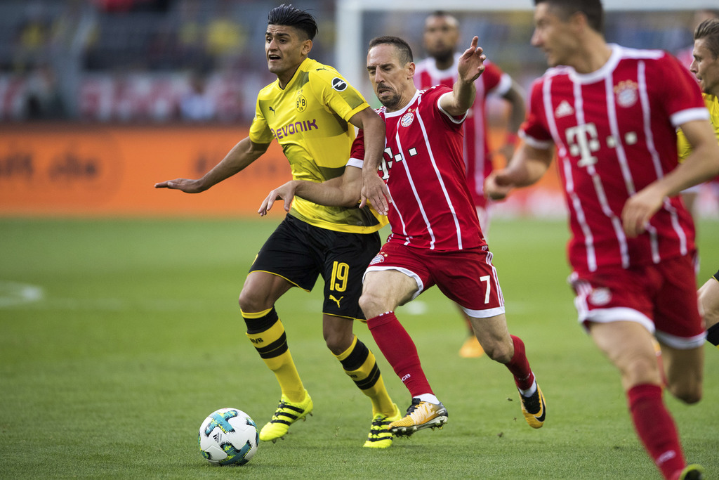 Dortmund's Mahmoud Dahoud, left, and Bayern's Frank Ribery vie for the ball during the Supercup soccer final between FC Bayern Munich and Borussia Dor...