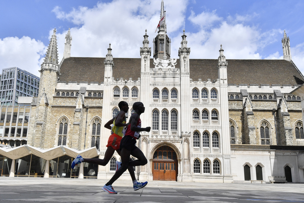 Kenya's Geoffrey Kipkorir Kirui, right, leads Ethiopia's Tamirat Tola past the Guildhall on his way to winning the gold medal in the Men's Marathon du...