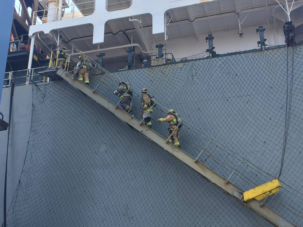 This photo courtesy of the Long Beach Fire Department shows firefighters boarding a ship responding to an hazmat incident in the Port of Long Beach, C...