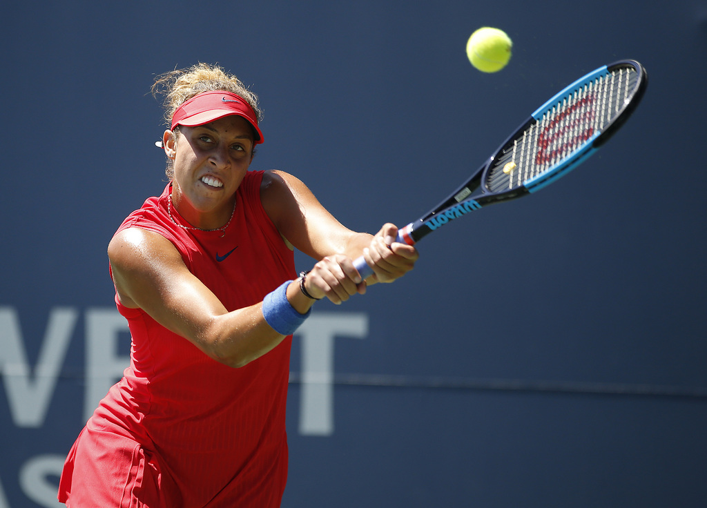 Madison Keys, of the United States, returns a backhand to compatriot Coco Vandeweghe during the finals of the Bank of the West Classic tennis tourname...