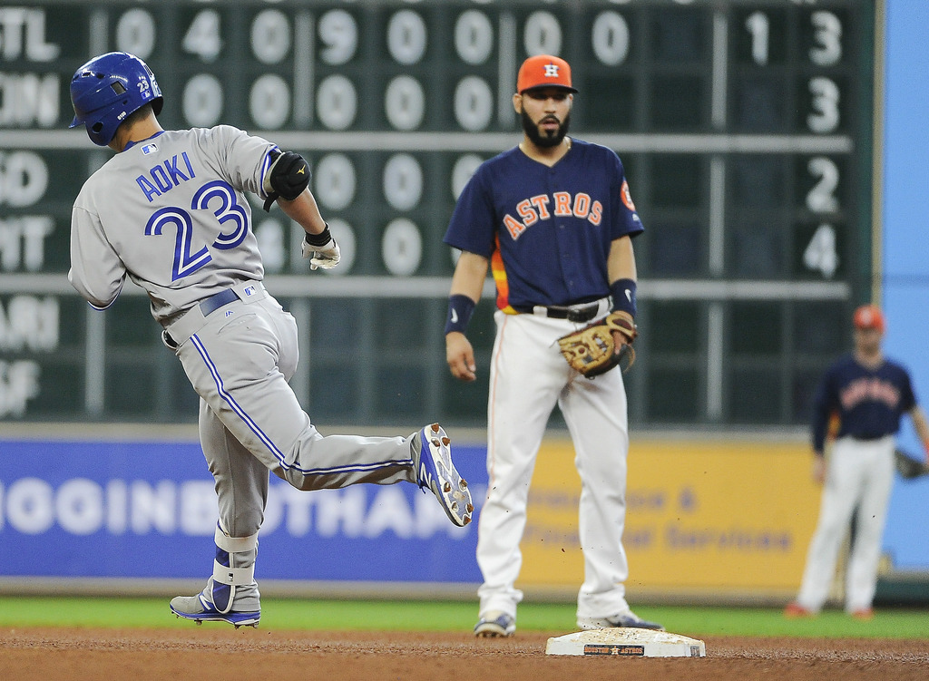 Toronto Blue Jays' Norichika Aoki (23) rounds the bases after hitting a two-run home run off Houston Astros starting pitcher Mike Fiers, as shortstop ...