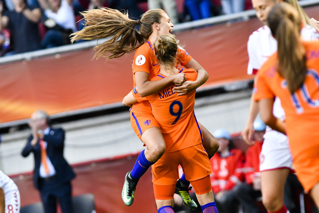 Vivianne Miedema, number 9, of the Netherlands celebrates with teammate Lieke Martens after she scores her side's fourth goal during the Women's Euro ...