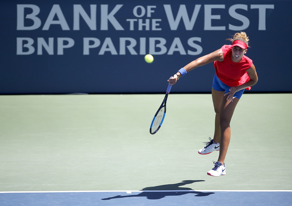 Madison Keys, of the United States, serves to compatriot Coco Vandeweghe during the finals of the Bank of the West Classic tennis tournament in Stanfo...