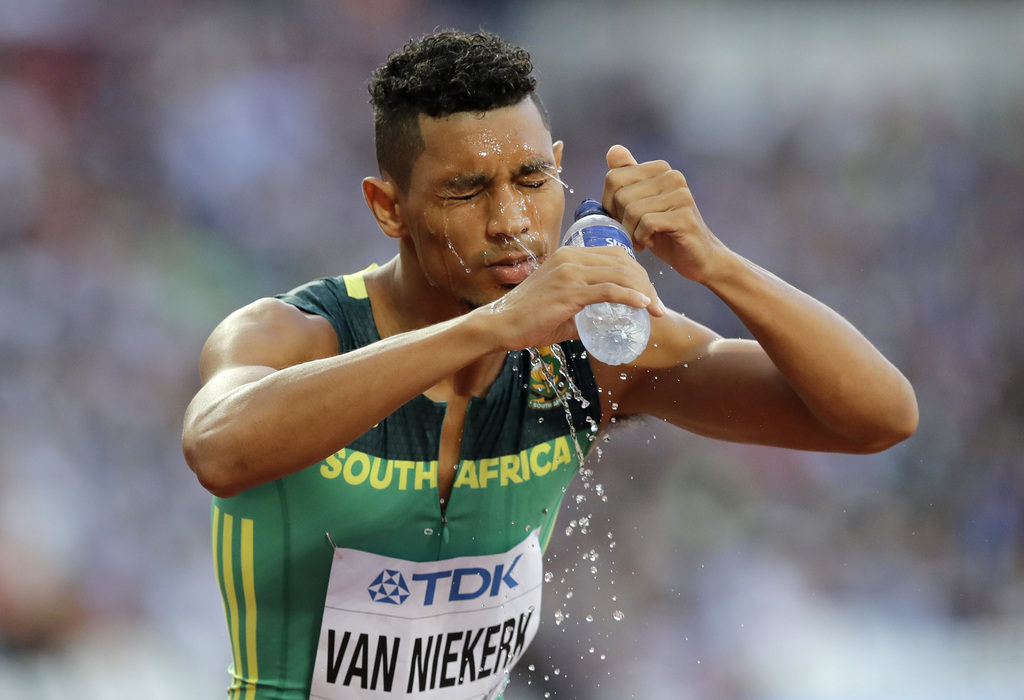 South Africa's Wayde Van Niekerk wets his face before competing in a Men's 400 meters semifinal during the World Athletics Championships in London Sun...