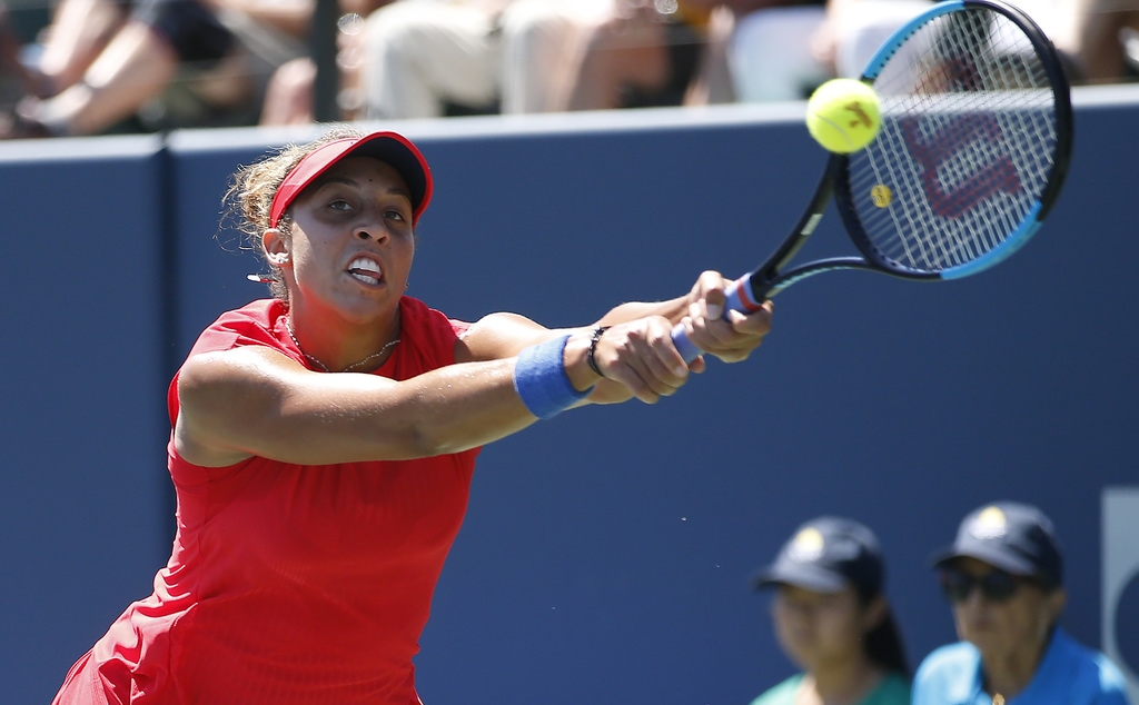 Madison Keys, of the United States, returns to Coco Vandeweghe, of the United States, during the finals of the Bank of the West Classic tennis tournam...
