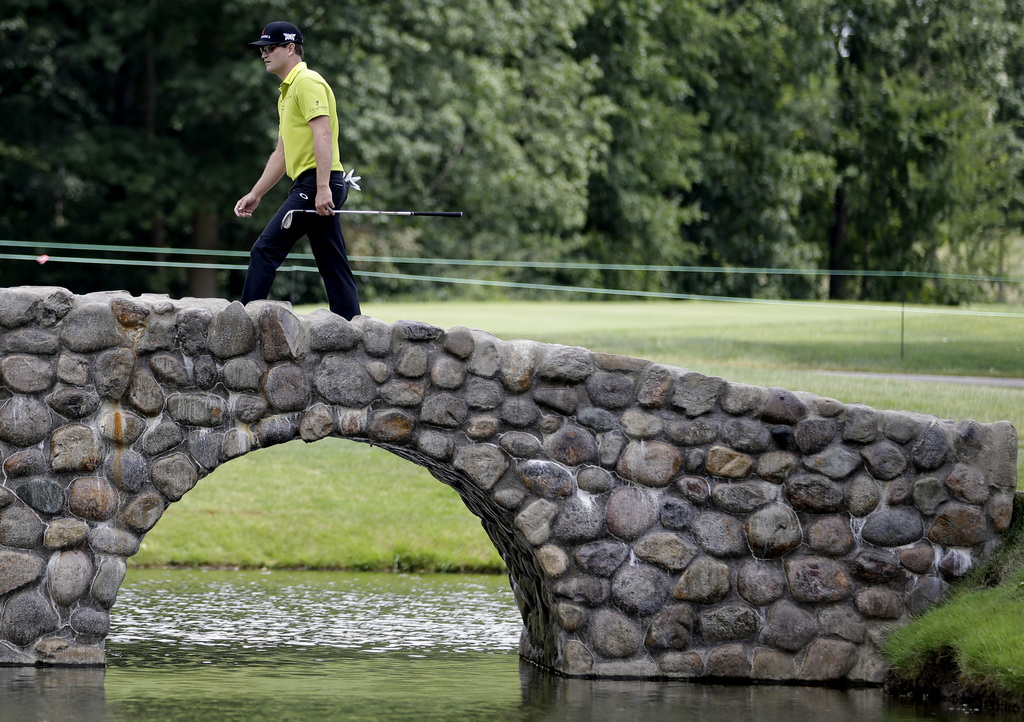 Zach Johnson walks over a bridge on the third hole during the final round of the Bridgestone Invitational golf tournament at Firestone Country Club, S...