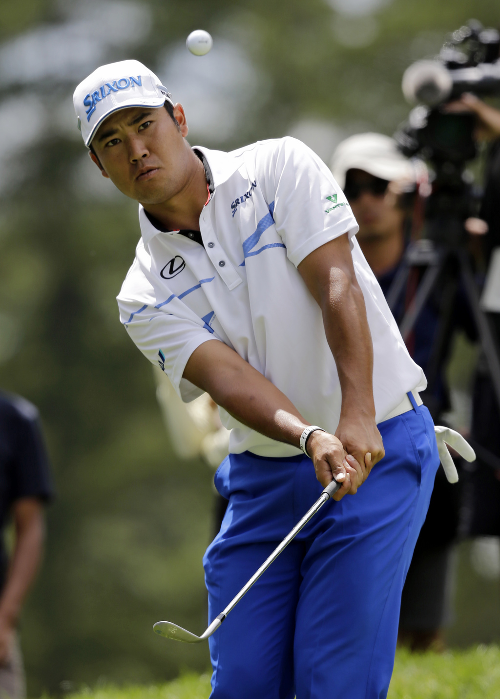 Hideki Matsuyama, from Japan, chips in the ball for an eagle on the second green during the final round of the Bridgestone Invitational golf tournamen...