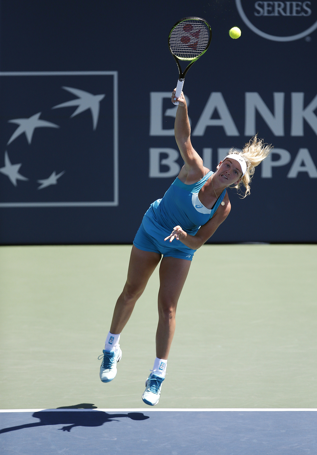 Coco Vandeweghe, of the United States, serves to Madison Keys, of the United States, during the finals of the Bank of the West Classic tennis tourname...