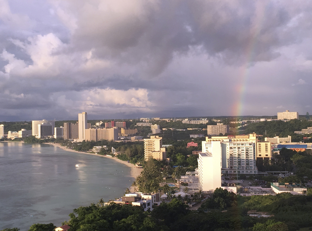 A rainbow appears over Tumon Bay, Guam Sunday, Aug. 13, 2017. Residents of the U.S. Pacific island territory of Guam face a missile threat from North