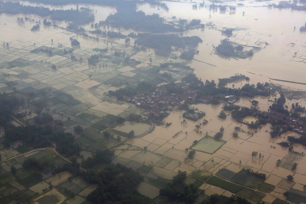 An ariel view of flooded land is seen at Dhanusha District, Nepal, Sunday, Aug. 13, 2017. Landslides and flooding triggered by heavy rain have killed ...