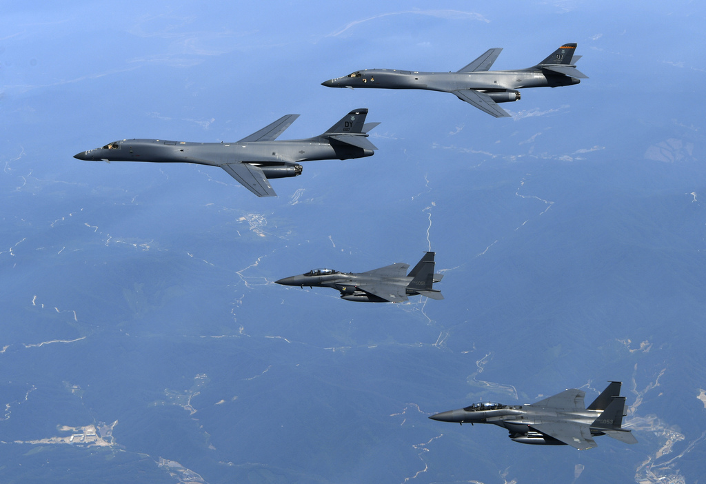 FILE - In this June 20, 2017 file photo provided by South Korean Defense Ministry, U.S. Air Force B-1B bombers, top, and second from top, and South Ko...