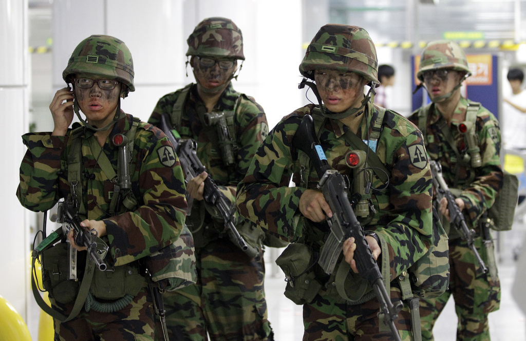 FILE - In this Aug. 17, 2010 file photo, South Korean army soldiers hold their weapons during an anti-terror exercise carried out as part of Ulchi Fre...