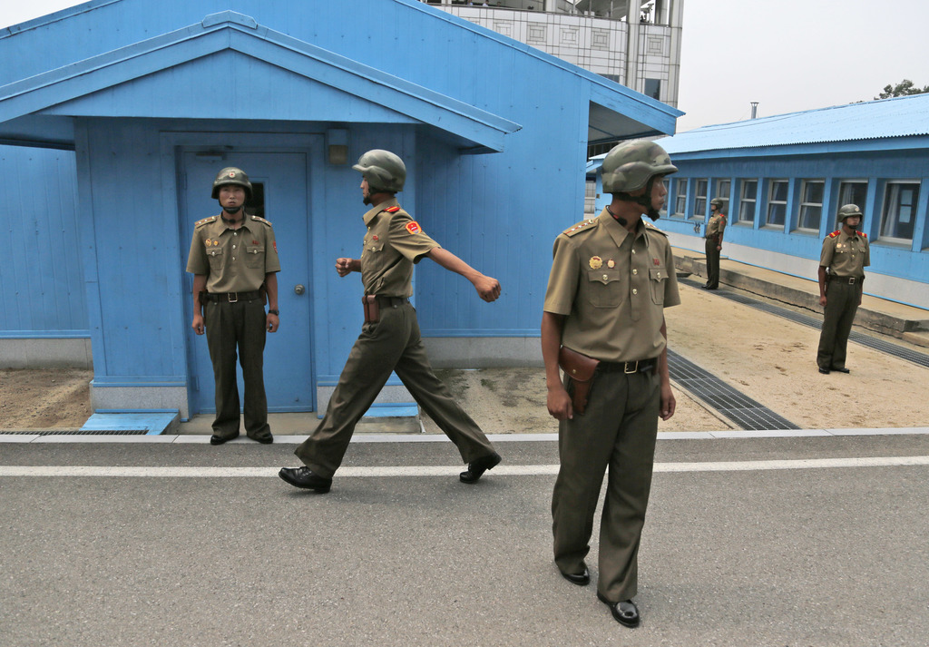 FILE - In this Aug. 15, 2015, file photo, North Korean soldiers stand guard at the Demilitarized Zone (DMZ) in North Korea, on Liberation Day, the ann...