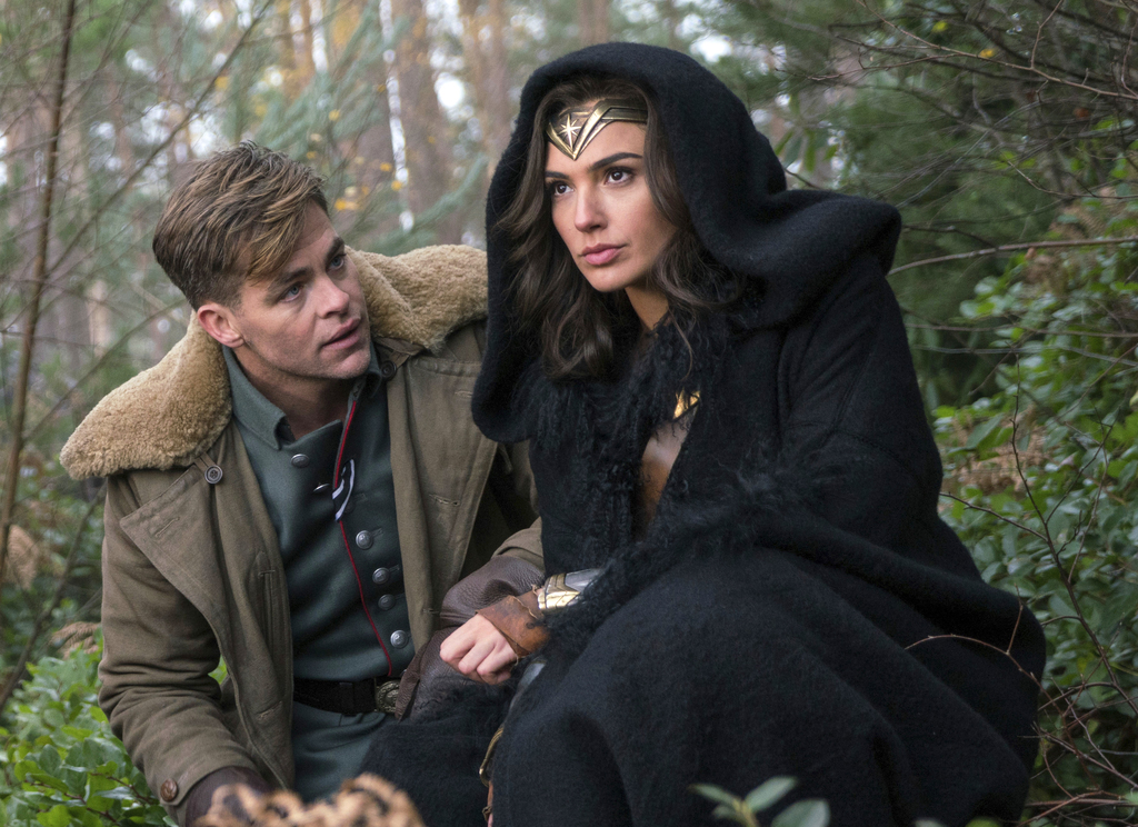 """This image released by Warner Bros. Pictures shows Chris Pine, left, and Gal Gadot in a scene from, """"Wonder Woman."""" The film, directed by Patty Jenkin..."""