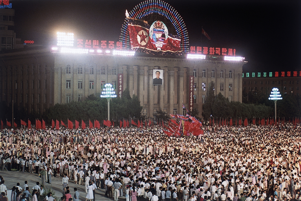 FILE - In this Aug. 15, 1990 file photo, some of the 100,000 people who gathered at Kim II Sung Square in Pyongyang, North Korea, to celebrate the 45t...